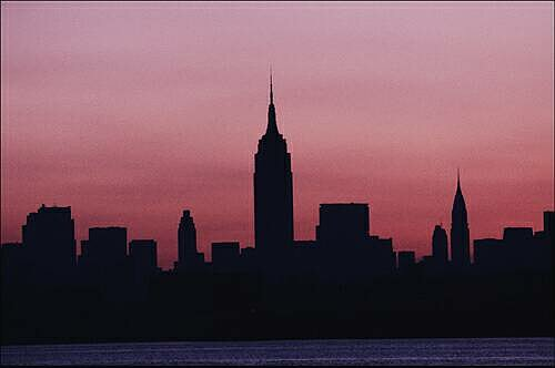 Description: The New York City skyline seen from New Jersey at dawn shows no lights due to the electric blackout of 1977. Credit: ©Allan Tannenbaum